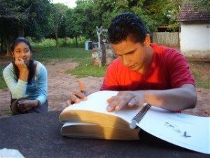 A young man in Paraguay reads his Braille Bible
