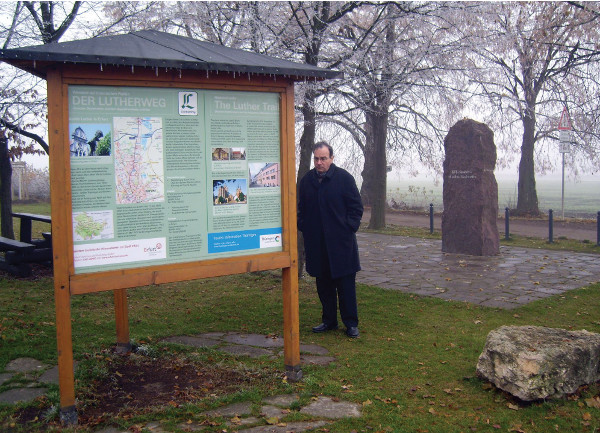 "President Bugbee in the country near Stotternheim. The stone marking the place Luther ""wasshown the way"" stands behind him."