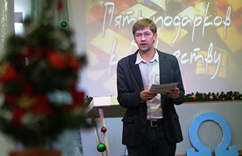 Rev. Alexey Navrotskyy leads worship Christmas Eve.
