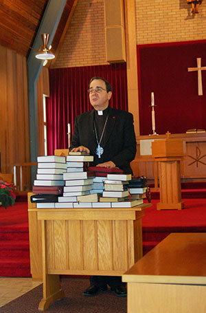 President Bugbee blesses the Bibles of those committing to daily Bible reading.