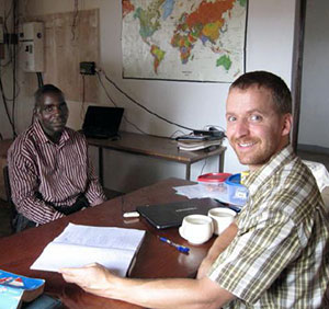 Rev. Mike Kuhn at work with his language resource person, A Muslim Nizaa named Yougouda Bah.