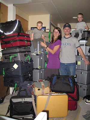 On the way to Cameroon: The Kuhns pose with their 14 checked bags and six carry-ons before departing for Cameroon.
