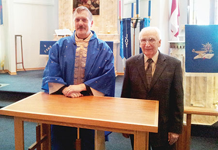 Rev. Richard Beinert and Al Judt following the December dedication of Al's table.