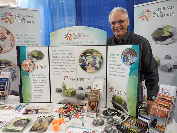 Executive Director Stephen Klink and the LLL Canada display.