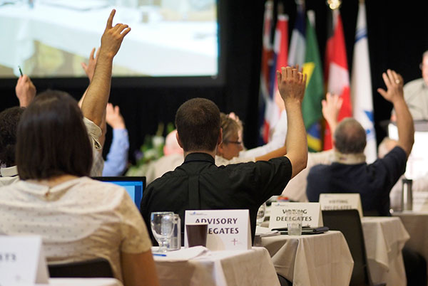 Delegates to the convention vote.