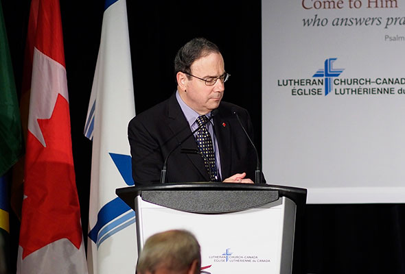 President Robert Bugbee leads the Convention in prayer for Moncton.