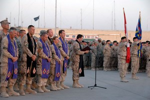 Capt. Padre Ristau (in black stole) participates in a ramp ceremony for Private (Pte) Sébastien Courvey, who was killed in action on July 16, 2009 while conducting operations in the Panjwai District of Afghanistan.