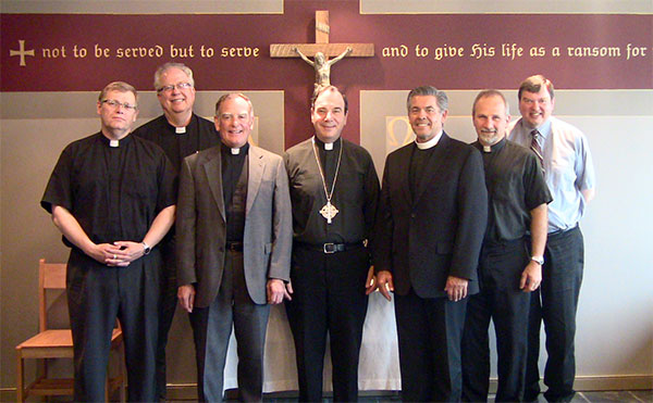 Rev. Phil Gagnon (NALC Provisional Dean for Canada); Rev. Larry Vogel (Associate Executive Secretary of the LCMS' CTCR); Rev. Mark Chavez (NALC General Secretary); Rev. Dr. Robert Bugbee (LCC President); Rev. Dr. David Wendel (NALC Assistant to the Bishop for Ministry and Ecumenism); Rev. Warren Hamp (Chairman of LCC's CTCR); Rev. Thomas Prachar (LCC Central District President).