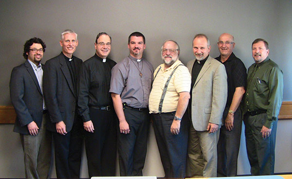 Current members of the CTCR meet in Winnipeg. (Left to right: Paul Walrath, Rev. Dr. Thomas Winger, President Robert Bugbee, Rev. Joel Kuhl, Rev. James Heinbuch, Rev. Warren Hamp, Clifford Pyle, and Rev. Dr. James Gimbel).