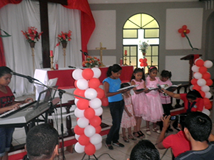 A group of students perform during the Reformation Day service.