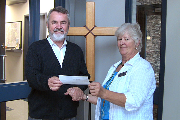 NAme presents Dr. Neitzel a cheque.