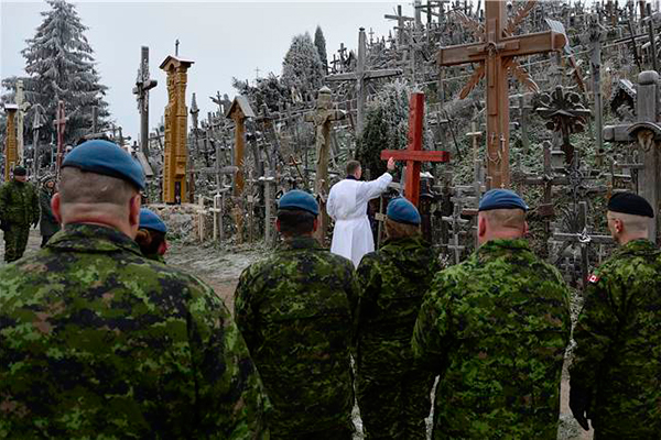 LCC chaplain dedicates cross at Lithuania's Hill of Crosses