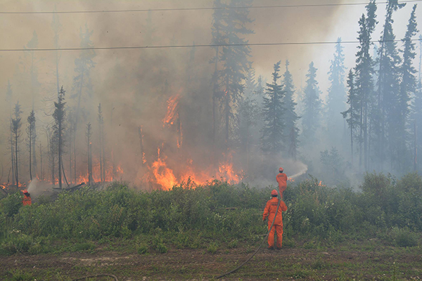 Firefighters fighting fire in northern Saskatchewan on July 5.
