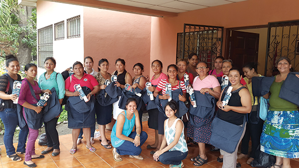Nicaraguan deaconesses pose with new laptop bags and surge protectors.