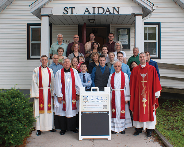 Members of St. Andrew's gathered on July 26 for the Installation of Rev. Mark Smith as the East District's Circuit Rider for Atlantic Canada. In front from left to right are: Chaplain David Jackson, East District President Paul Zabel, Rev. Dr. John Stephenson, and Rev. Mark Smith.