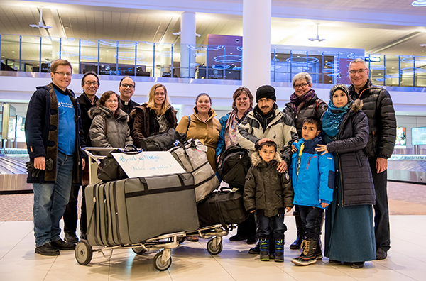 Staff from LCC, CLWR, and the ELCIC welcome a family of Syrian refugees to Winnipeg. (Image Courtesy: ELCIC Communications).