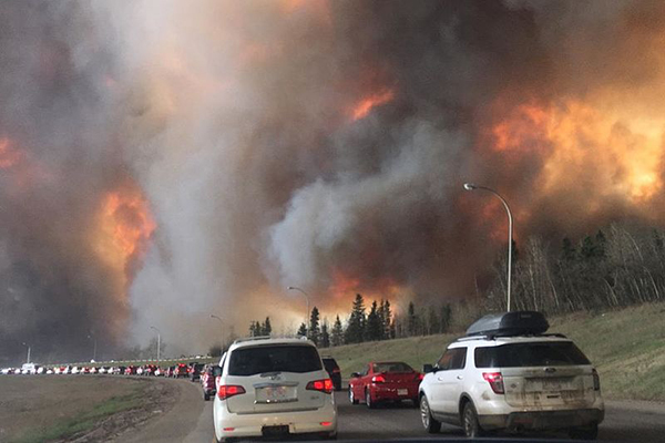 Bumper to bumper traffic as Fort McMurray residents flee wildfire.