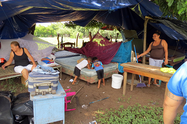 Families sleep in a make-shift shelter, following earthquakes and aftershocks.
