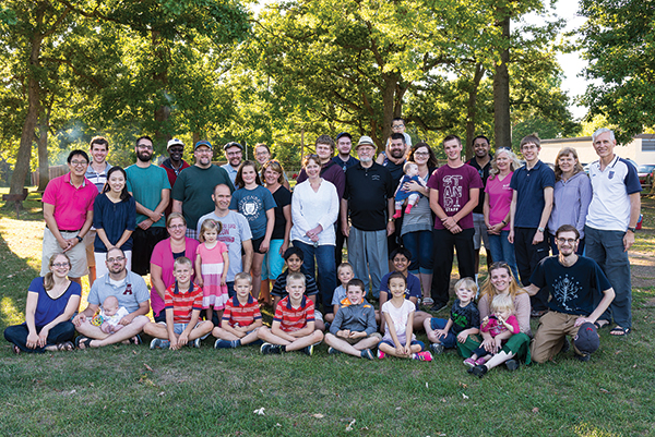 Faculty, students, and family at CLTS' opening barbecue.