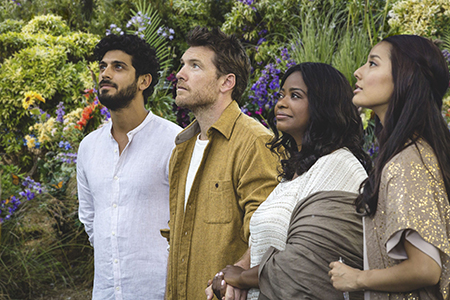 Mack Phillips (Sam Worthington—second from left) along with the The Shack's depiction of the Trinity: Jesus (Aviv Alush - left), Papa (Octavia Spencer -second from right), and Sarayu (Sumire Matsubara - right).