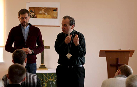 LCC President Bugbee lectures at SELCU's seminary, while Rev. Alexey Navrotskyy translates.