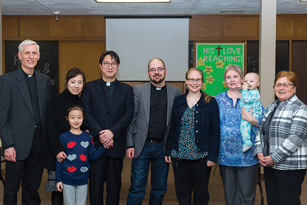 Rev. Dr. Thomas Winger; Terri, Sophia, and Isaac Paik; Matthew and Laurin Fenn; Iris Barta with Isaac Fenn; and Janice Buchner.