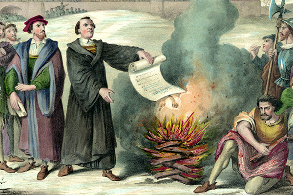 Luther burns the papal bull. (Detail from 19th century lithograph by H. Schile, after the original of H. Brüchner.)
