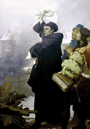 Luther burns the papal bull. (Detail from 1872 painting by Paul Thumann).